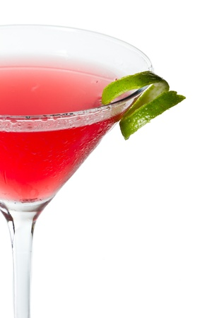 isolated cosmopolitan on a white background garnished with a lime twist photo