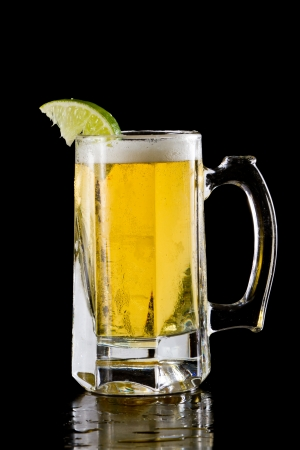 frozen mug with a lager style beer isolated on a black background photo
