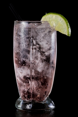 cocktail served in a tall glass with sparkling water, vodka and a splash of cranberry juice photo