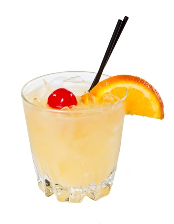 traditional whiskey sour cocktail served on the rocks garnished wiht a red cherry and an orange slice