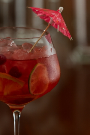red sangria served in a wine glass with fresh organic fruit photo