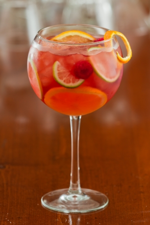 red sangria served in a wine glass with fresh organic fruit