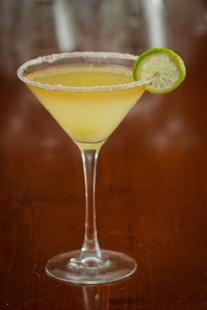 classic margarita served chilled in a martini glass with a float of orange liqueur photo