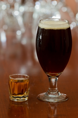 shot: beer and a shot of whiskey served on a busy out of focus bar Stock Photo