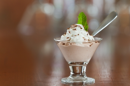 glass topped: small martini glass with dark chocolate mousse topped with whipped cream and a mint leaf