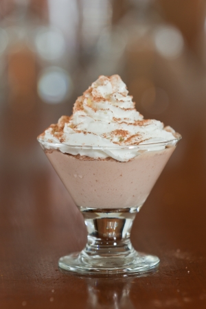 glass topped: small martini glass with dark chocolate mousse topped with whipped cream