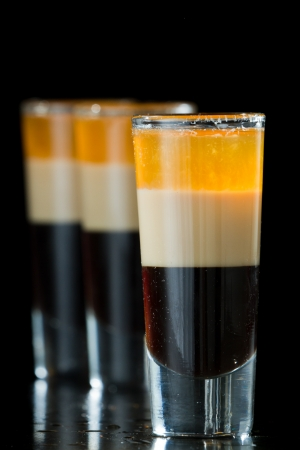 b 52 shots layered and served on a isolated black background photo