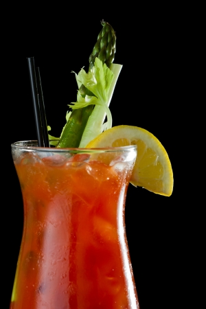tall bloody mary isolated on a black background photo