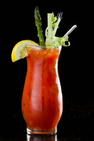 bloody: tall bloody mary isolated on a black background