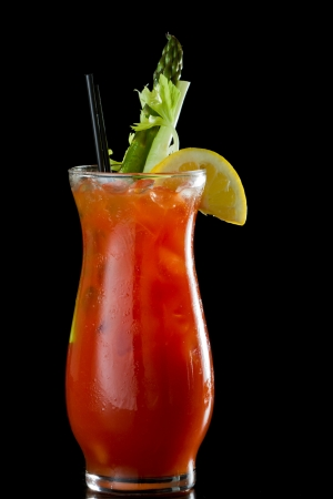 tall bloody mary isolated on a black background