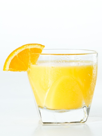 alcohol screwdriver: closeup of a glass filled with fresh orange juice garnished with an orange slice isolated on a white background Stock Photo