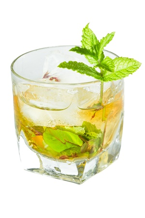muddle: classic Kentucky derby cocktail the mint julep isolated on a white background