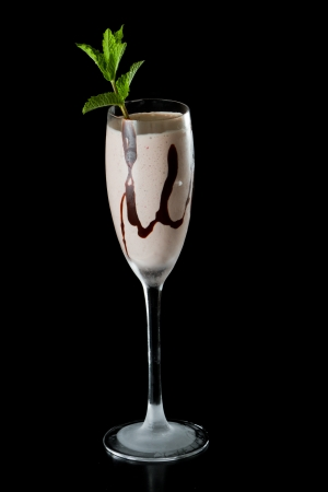 chocolate shake: chocolate shake served in a champagne flute garnished with fresh mint