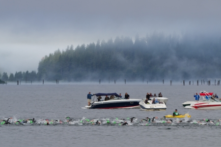 COEUR D ALENE, ID - JUNE 23: Competitors for the ironman triathlon swimming early morning of June 23 2013 in Coeur d' Alene Idaho Editorial