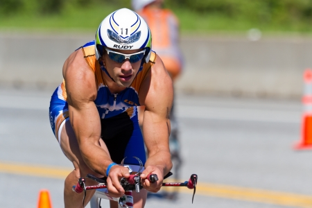 road cycling: COEUR D ALENE, ID -  JUNE 23: Nathan Birdsall, Triathlete on the bike part of the ironman triathlon, June 23 2013 in Coeur d Alene Idaho