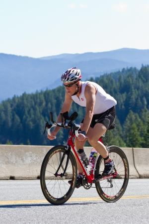 road cycling: COEUR D ALENE, ID -  JUNE 23: Triathlete on the bike part of the ironman triathlon, June 23 2013 in Coeur d Alene Idaho