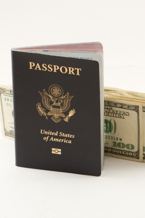 American passport with  hundreds of dollars isolated on a white background Stock Photo - 20991009