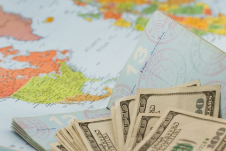 American passport with  american currency and a map as a background Stock Photo - 20991012