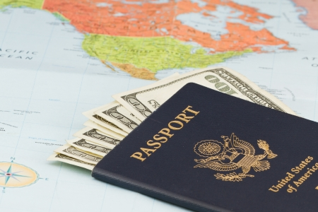 American passport with  american currency and a map as a background Stock Photo - 20991031