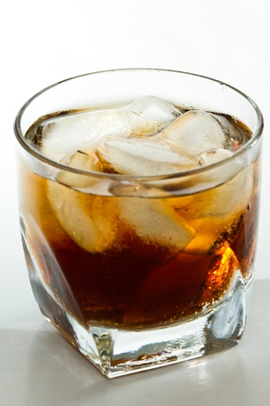 cuba libre, rum and cola cocktail served in a short glass photo