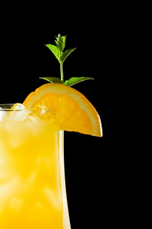 oj: screwdriver, fresh orange juice with vodka served in a stem glass on a dark bar