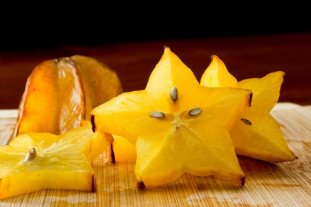 bard: slices of carambola fruit on a cutting bard with star shapes