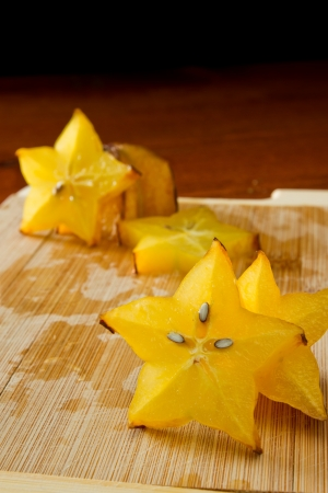 slices of carambola fruit on a cutting bard with star shapes
