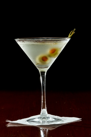 classic cocktail served with pimento stuffed cocktail olives photo