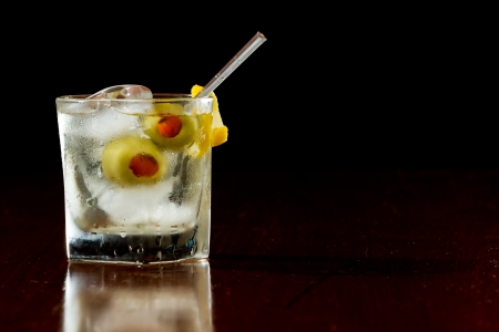 vermouth: classic cocktail served  on the rocks with pimento stuffed cocktail olives and a lemon twist