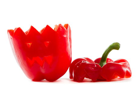 hand carved red bell pepper for halloween isolated on a white background photo