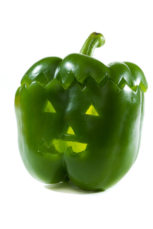hand carved green bell pepper for halloween isolated on a white background Stock Photo - 22407805