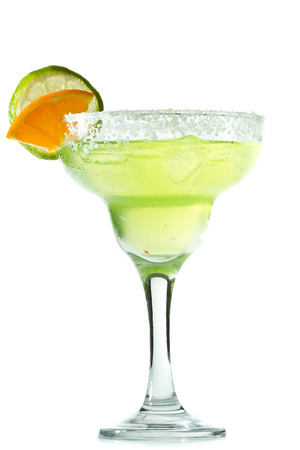 classic margarita with a salt rim, lime and orange garnish isolated on a white background photo
