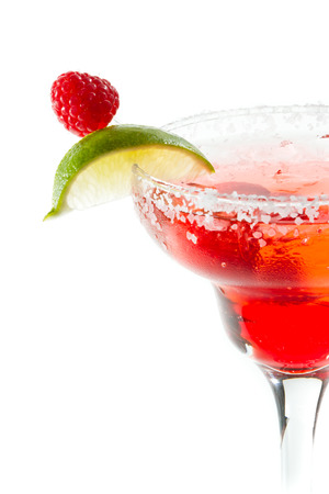 refreshing raspberry margarita isolated on a white background garnished with a lime slice