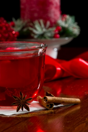 christmas morning tea served in a clear glass with spices photo