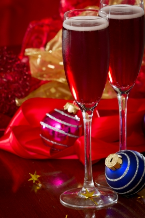 Sparkling wine served for Christmas on a table with decorations and ornaments photo