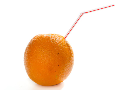 oj: Fresh orange isolated on a white background with a straw in it