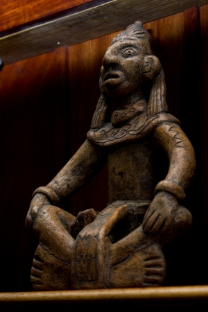 artifact: replica of a mayan artifact on a shelf in the tropical rain forest of Belize