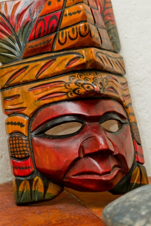 hand made traditional, maya masks on a shelf in Belize