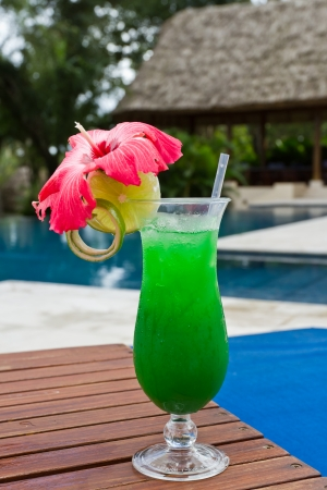 fresh tropical juice cocktail served pool side in Belize
