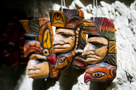 group of hand made masks for sale in a local shop in Belize