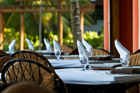 outdoor dining, tables set in the afternoon in the tropical beach of Belize Stock Photo