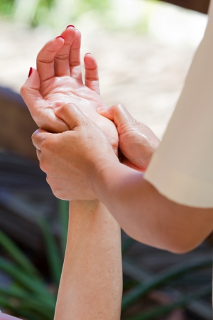 caucasian woman receiving a hand massage on vacation photo