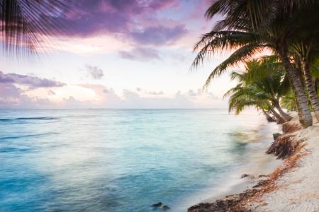 Beautiful tranquil beach sun rise in southern Belize