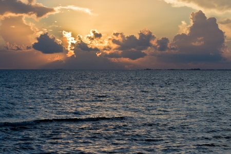Beautiful tranquil beach sun rise in southern Belize photo