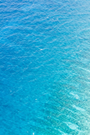 aerial view of clear blue water of the caribbean coast of Belize photo