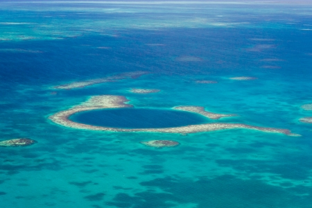 barrier: aerial view of the great blue hole of the coast of Belize