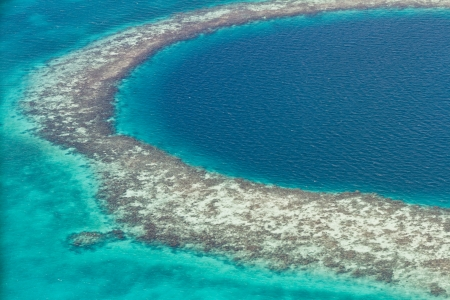 aerial view of the great blue hole of the coast of Belize photo