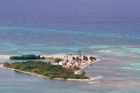 Aerial view of the Lighthouse Caye of the coast of Belize photo