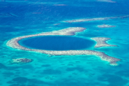 tourism in belize: aerial view of the great blue hole of the coast of Belize