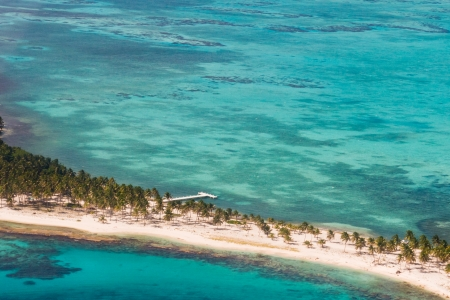 san pedro: aerial view of the barrier reef of the coast of San Pedro, Belize. with small land masses or cayes Stock Photo